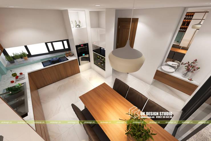 NHÀ PHỐ KẾT HỢP VĂN PHÒNG:  Phòng ăn by UK DESIGN STUDIO - KIẾN TRÚC UK