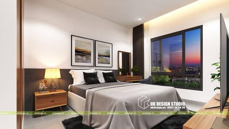 NHÀ PHỐ KẾT HỢP VĂN PHÒNG:  Phòng ngủ by UK DESIGN STUDIO - KIẾN TRÚC UK