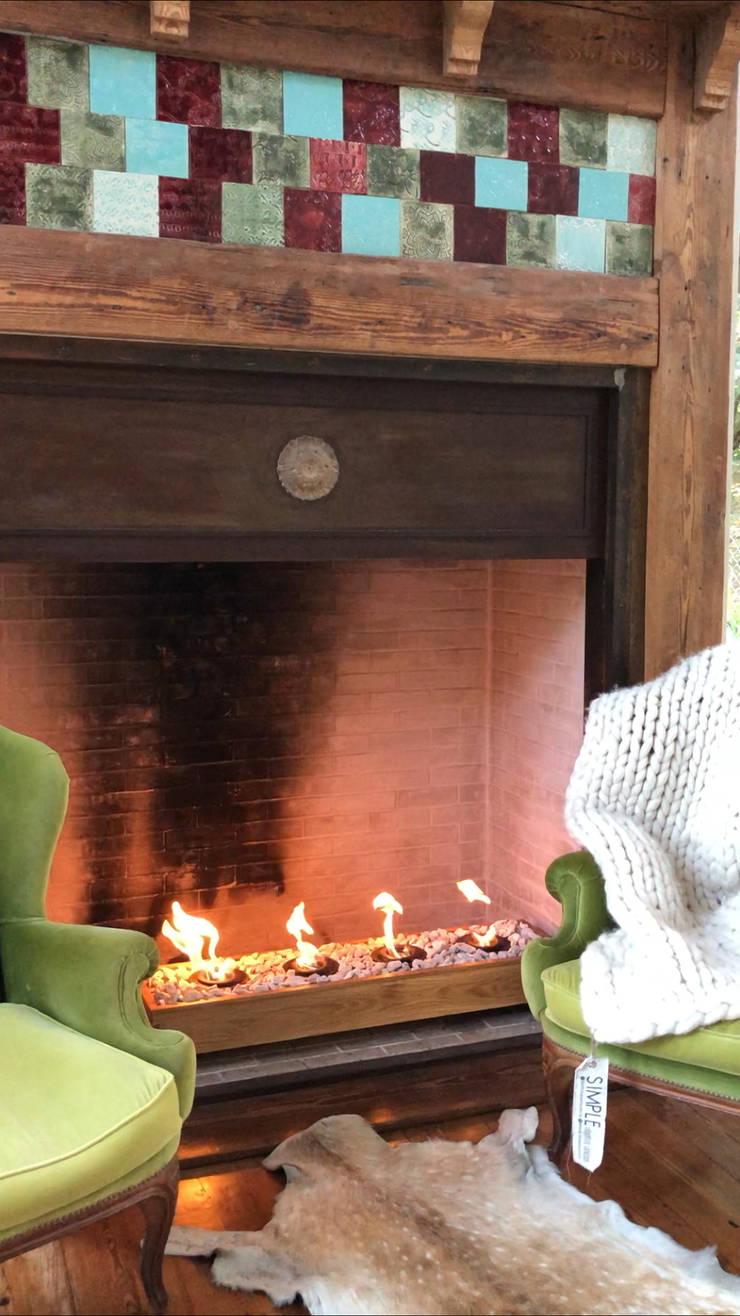 Nuevos modelos de fuegos para disfrutar todo el año: Paisajismo de interiores de estilo  por Simple Objetos Unicos