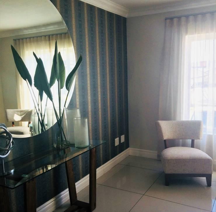 Turquoise Delight:  Corridor & hallway by Sophistique Interiors