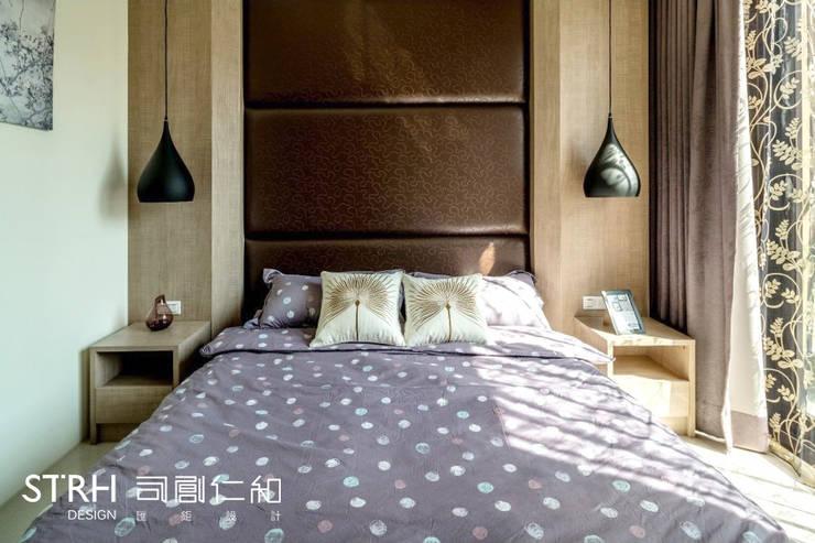 帝闊建設實品屋:  臥室 by 司創仁和匯鉅設計有限公司