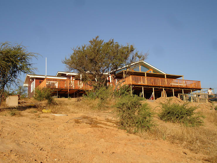 TERRAZA : Casas unifamiliares de estilo  por ARKITEKTURA