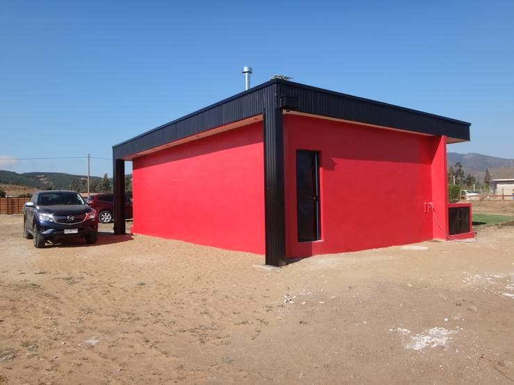 QUINCHO FACHADA SUR ORIENTE: Casas unifamiliares de estilo  por ARKITEKTURA