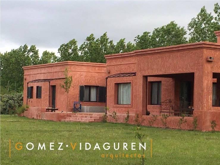 Casa LO: Casas de estilo  por Gomez Vidaguren Arquitectos,