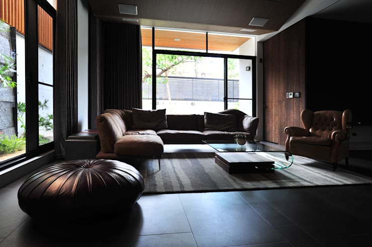 Media room by 黃耀德建築師事務所  Adermark Design Studio,