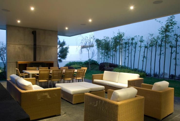 Casa EM : Salas de estilo  por TaAG Arquitectura