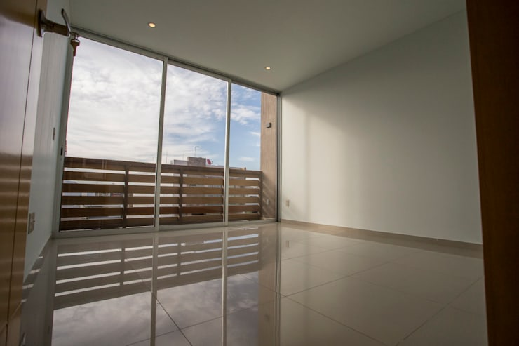 Altavista Residencial: Recámaras de estilo  por TaAG Arquitectura