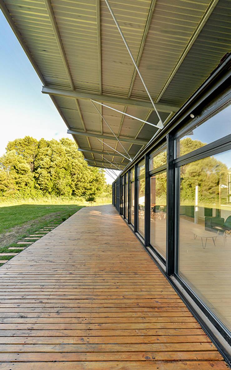Terraza Norte: Terrazas  de estilo  por mutarestudio Arquitectura