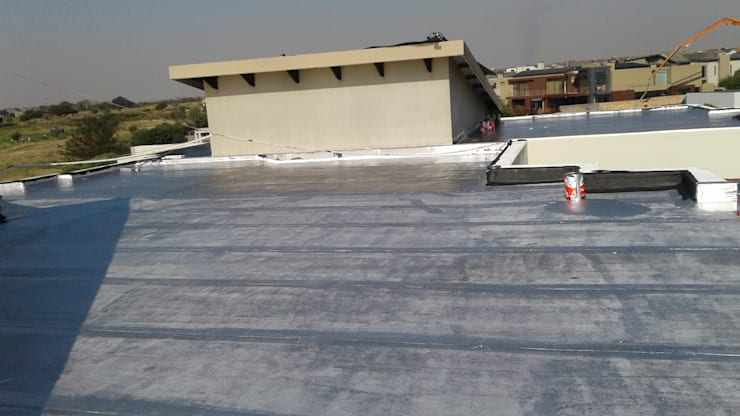 Waterproofing of a residential house slab roof in Serengeti Surburbs:   by Bem-Co Holdings