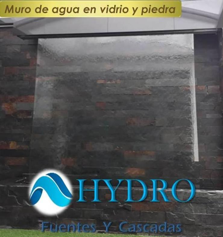 Muro de Agua y Piedra: Edificios de oficinas de estilo  por HYDRO FUENTES Y CASCADAS