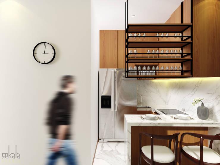 Interior Rumah Cutra Harmoni:  Dapur by SEKALA Studio