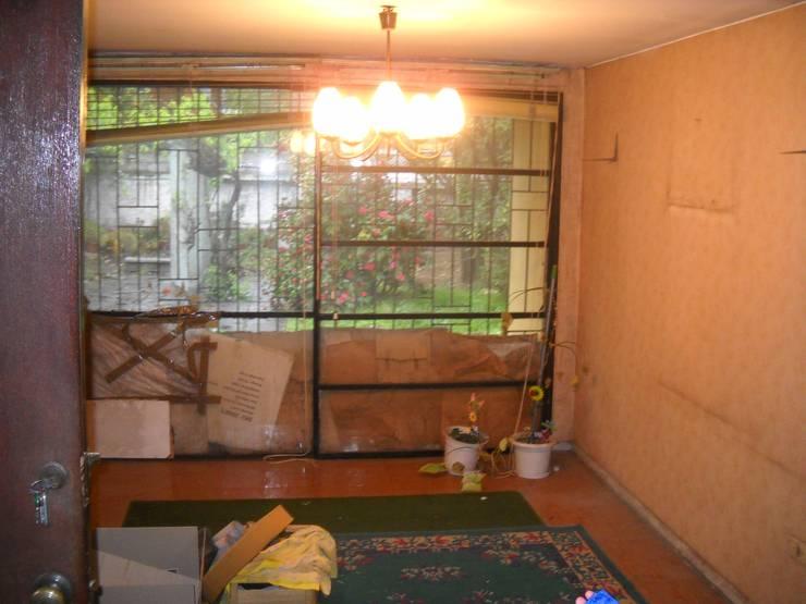 Interior del living antiguo: Livings de estilo  por DIEGO ALARCÓN & MANUEL RUBIO ARQUITECTOS LIMITADA