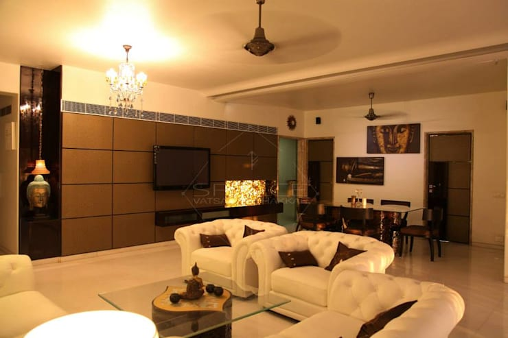 ohm mani padme hum.-mr & mrs. khanna's charming home.:  Living room by SPACCE INTERIORS