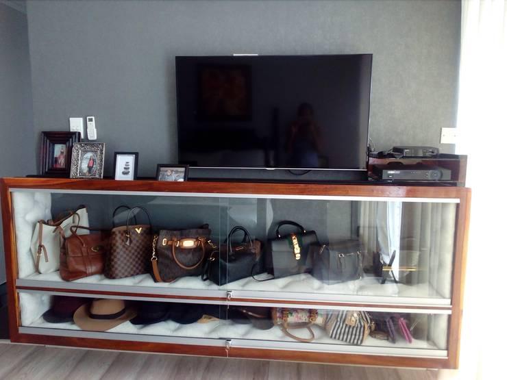 Designer bag display:   by Kori Interiors