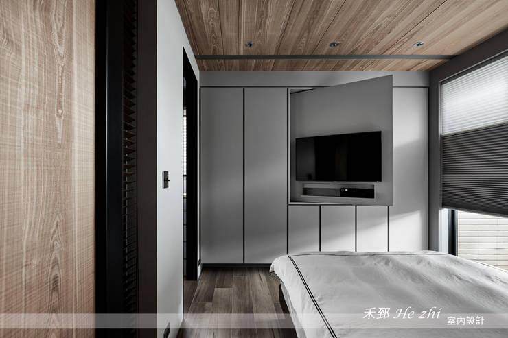 藏.密:  臥室 by 禾郅 室內設計
