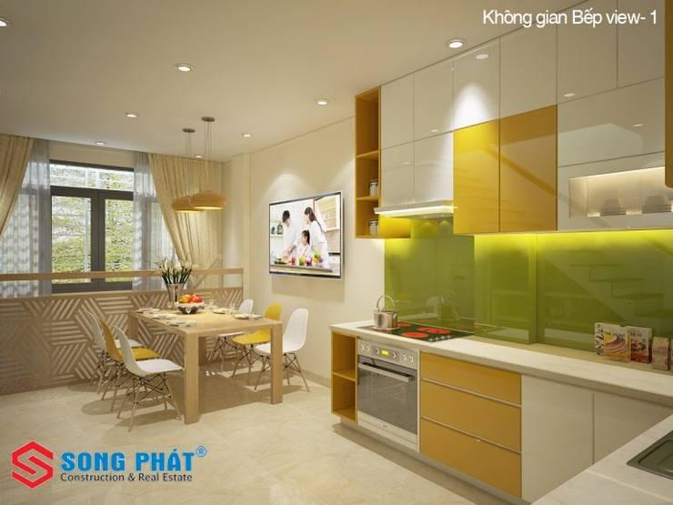 Mấu thiết kế bếp chữ L đẹp phù hợp với không gian sống hiện đại:  Phòng ăn by Công ty TNHH Thiết Kế Xây Dựng Song Phát