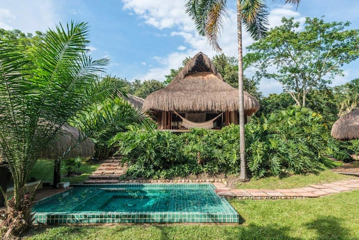 Casa Mesa de Yeguas: Piscinas de estilo  por NOAH Proyectos SAS, Tropical