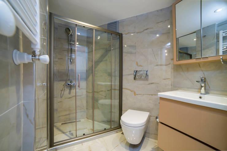 Casas de banho  por Sonraki Mimarlık Mühendislik İnş. San. ve Tic. Ltd. Şti.