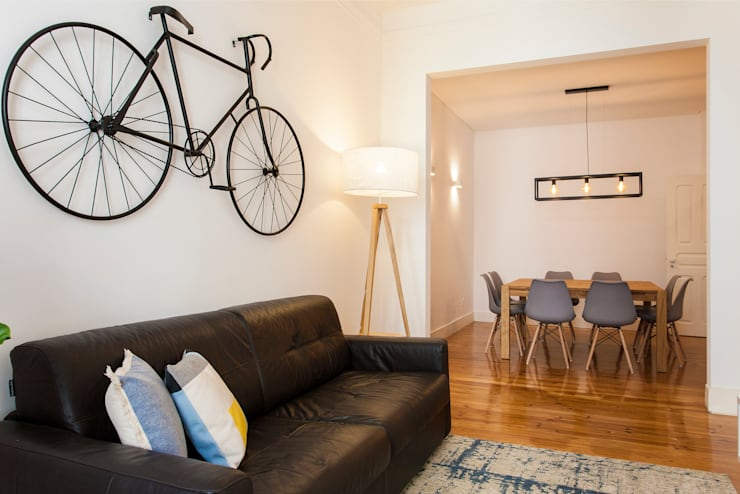 Sala de estar com vista para sala de refeições: Sala de estar  por Traço Magenta - Design de Interiores