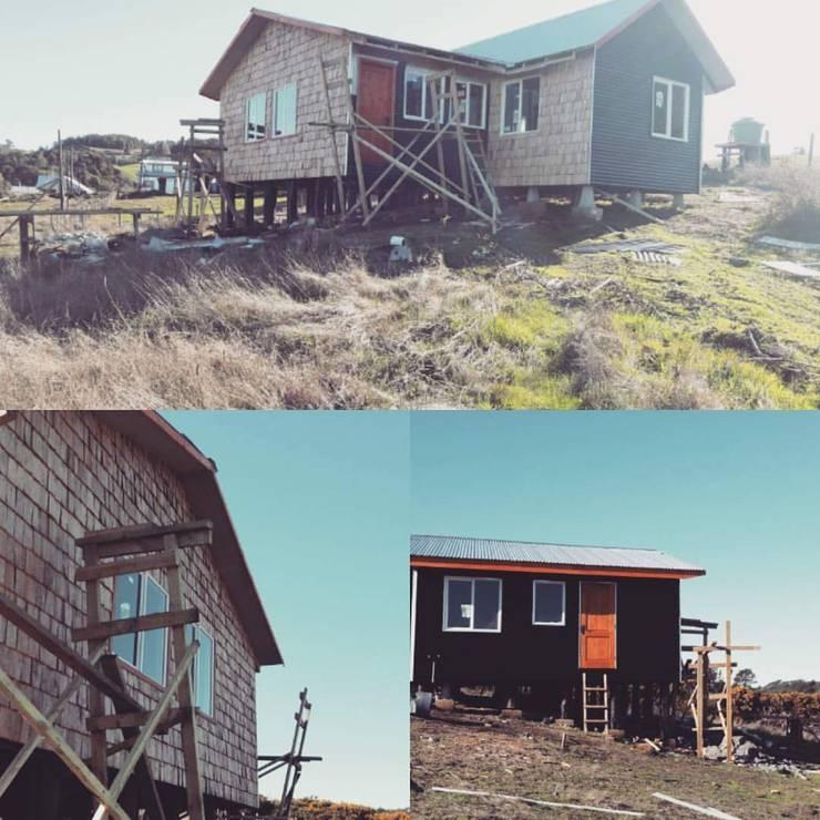 vivienda construida: Casas unifamiliares de estilo  por Ekeko arquitectura