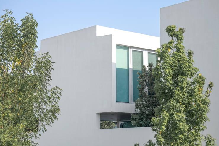 Casa Al Villa: Casas unifamiliares de estilo  por TaAG Arquitectura