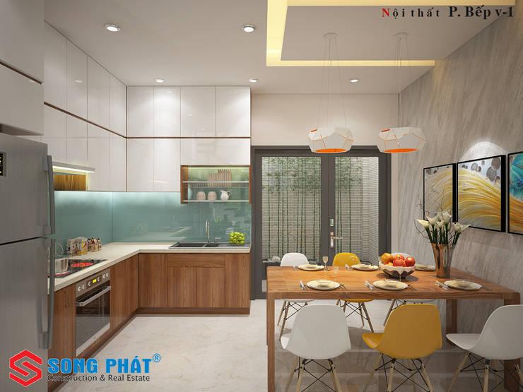 Bếp chữ L giúp cho không gian thêm sự tiện nghi.:  Nhà bếp by Công ty TNHH Thiết Kế Xây Dựng Song Phát