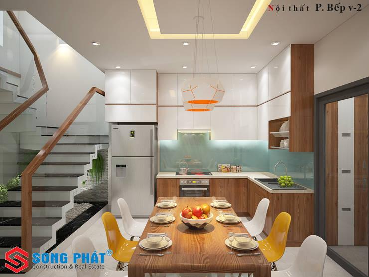 Màu vàng được thêm vào làm điểm nhấn cho căn phòng.:  Phòng ăn by Công ty TNHH Thiết Kế Xây Dựng Song Phát