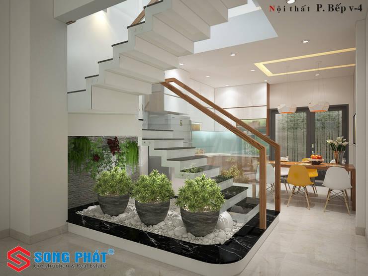 Tiểu cảnh trong nhà vừa là điểm nhấn vừa tạo sinh khí cho ngôi nhà:  Phòng khách by Công ty TNHH Thiết Kế Xây Dựng Song Phát