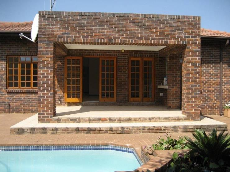 Dark face brick exterior:   by Deborah Garth Interior Design