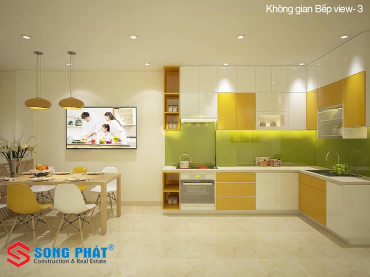 Màu sắc tươi sáng mang lại nhiều cảm hứng cho người nội trợ, đem đến bữa ăn ngon cho gia đình.:  Phòng ăn by Công ty TNHH TK XD Song Phát