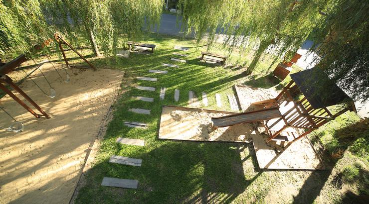 Emprendimiento Hábitat Residencias: Jardines de estilo  por ARQCONS Arquitectura & Construcción,