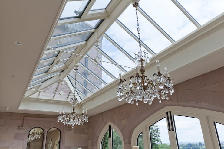 A striking solid construction orangery featuring doors with bronze inserts. Modern Conservatory by Vale Garden Houses Modern