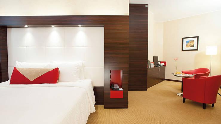 Decoración completa para estructuras hoteleras: Recámaras de estilo  por BMAA