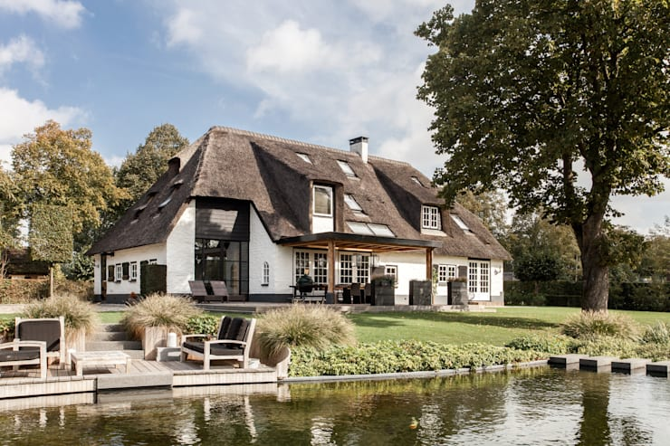 Houses by Bob Romijnders Architectuur & Interieur, Country
