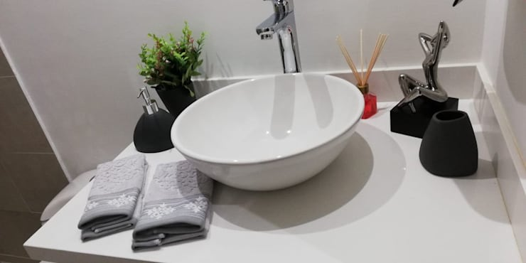 Capital Loft 103: Baños de estilo  por Mireya Pinilla Interior Design