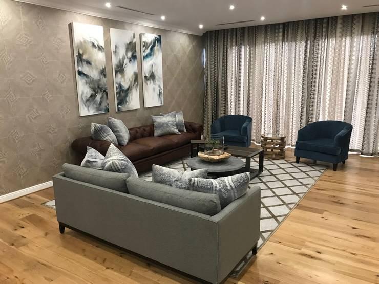 TV room:  Living room by Lean van der Merwe Interiors,