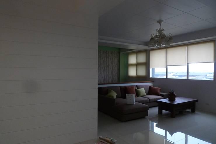 雙層造型隔間牆:  客廳 by 鄒迷藏設計|人衣人兒工作室