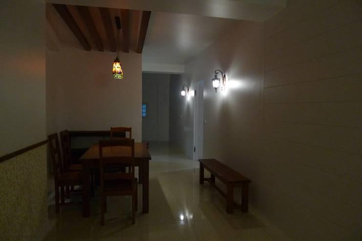 戶外壁燈加分效果:  餐廳 by 鄒迷藏設計|人衣人兒工作室