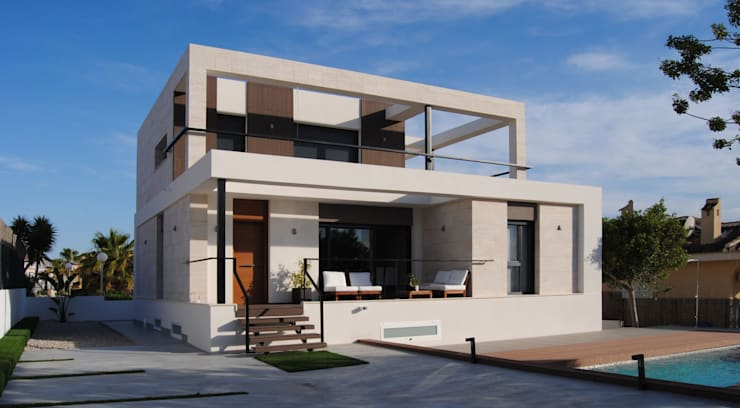Facha principal: Casas de estilo  de Loft26