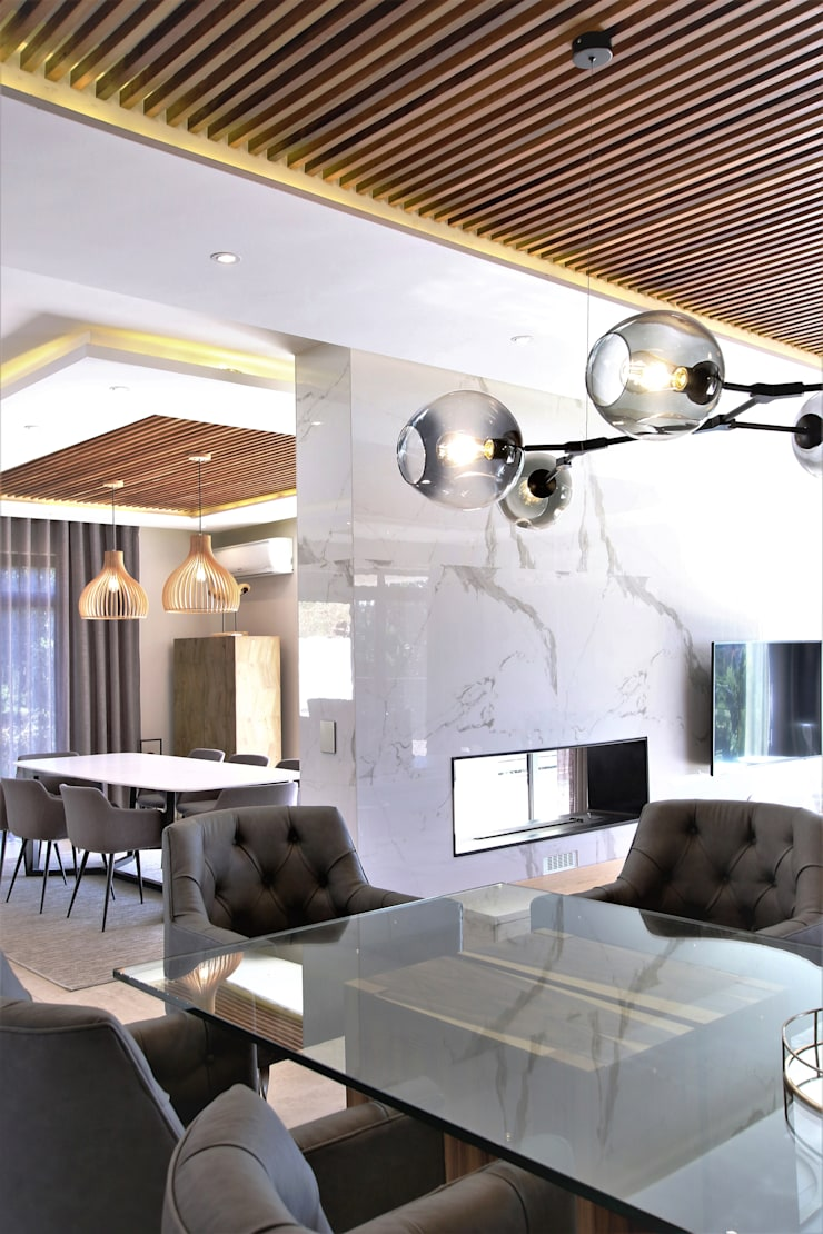 Dining room & Fireplace:  Dining room by JSD Interiors, Modern Wood Wood effect