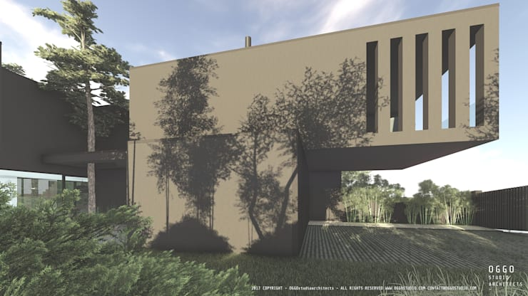 Fachada lateral de linhas contemporâneas: Casas  por OGGOstudioarchitects, unipessoal lda