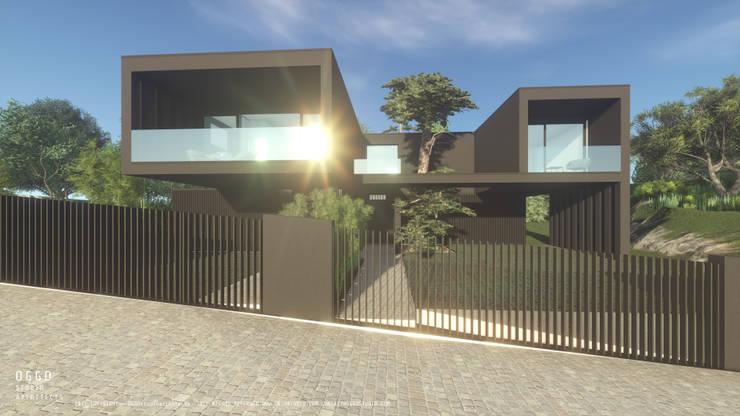 Frente de rua de casas geminadas: Casas  por OGGOstudioarchitects, unipessoal lda