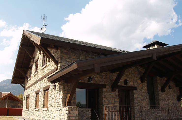Casas de campo de estilo  por Manuel Monroy Pagnon, arquitecto