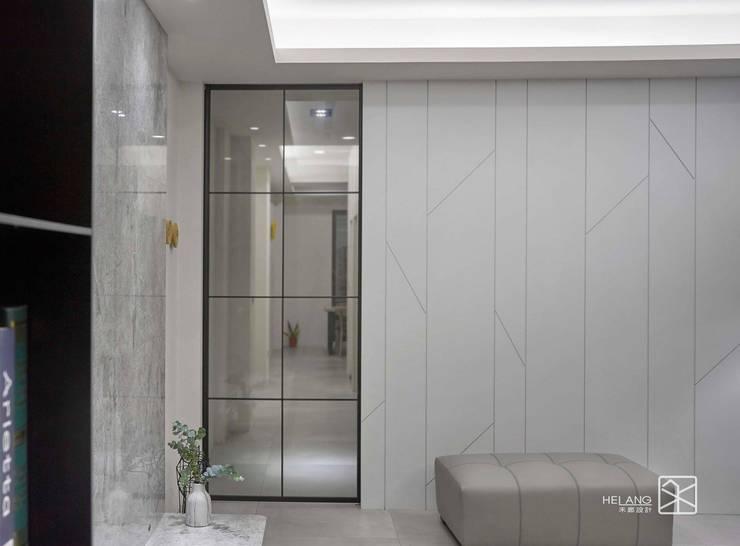 鐵件門:  客廳 by 禾廊室內設計