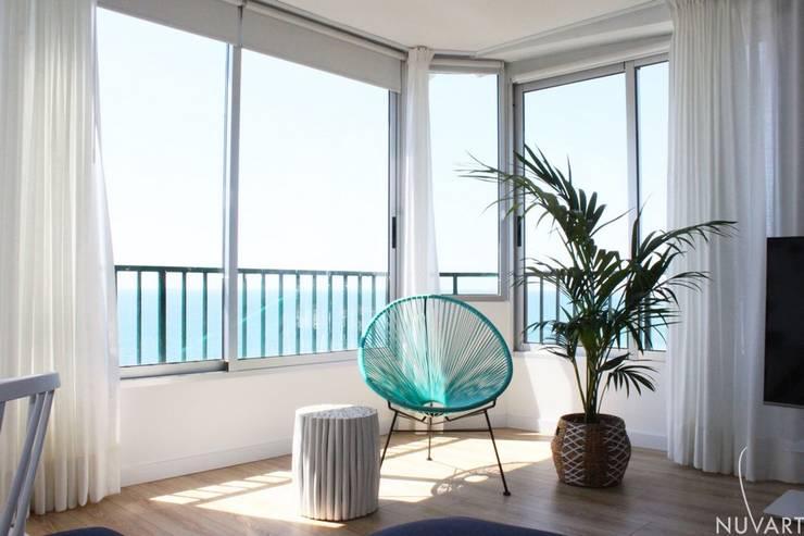 Zona relax: Salones de estilo  de NUVART,