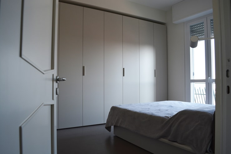Casa MB: Camera da letto in stile in stile Minimalista di Alessandro Jurcovich Architetto