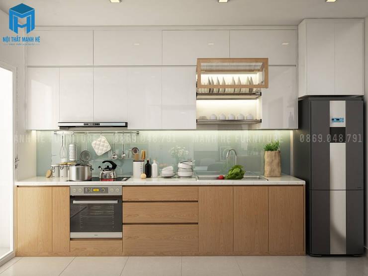 bếp được thiết kế gắn liền với không gian phòng khách :  Tủ bếp by Công ty TNHH Nội Thất Mạnh Hệ
