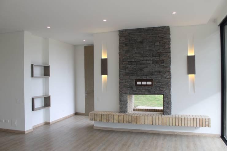 chimenea: Comedores de estilo moderno por IngeniARQ Arquitectura + Ingeniería