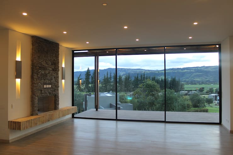 sala - comedor: Salas de estilo moderno por IngeniARQ Arquitectura + Ingeniería