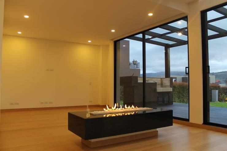 chimenea: Estudios y despachos de estilo  por IngeniARQ Arquitectura + Ingeniería, Moderno